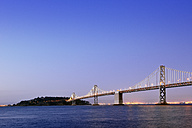 USA, California, San Francisco, view from Pier 14 on Oakland Bay Bridge and Yerba Buena Island at blue hour - BRF01371