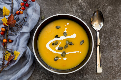 Creamed pumpkin soup in black bowl - SARF02914