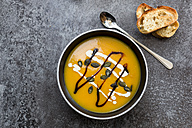 Creamed pumpkin soup in black bowl - SARF02917