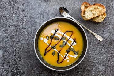 Creamed pumpkin soup in black bowl - SARF02917