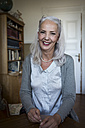 Portrait of smiling woman at home - JUNF00689