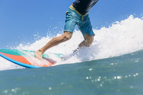 Indonesia, Bali, surfer standing on surfboard - KNTF00514