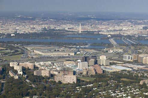 USA, Aerial photograph above South Arlington, Virginia looking across the Potomac River on Washington, D.C. - BCDF00097