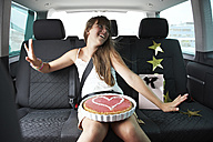 Happy girl n car with heart-shaped cake - FSF00532
