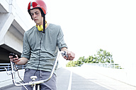Teenage boy on bicycle with cell phone - FSF00547