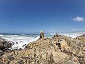 France, Bretagne, Finistere, Man standing at Atlantic coast - LAF01758