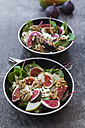 Bowls of baby chard salad with pear, figs, walnuts and feta - SARF02930