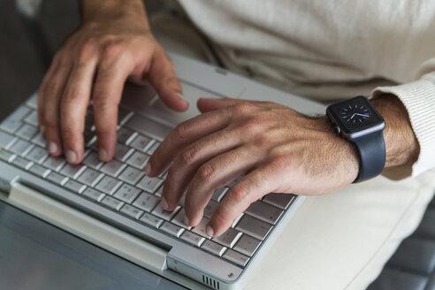 Man's hands using laptop, close-up - TCF05113