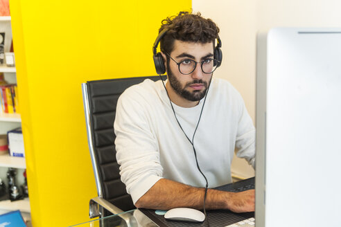 Young man working with computer in an office - TCF05119