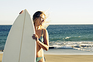 Spain, Tenerife, young blonde surfer on the beach - SIPF00872