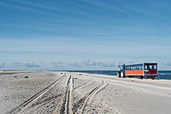 Denmark, Skagen, Grenen, tractor with trailer the beach - MJF02008