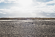 Denmark, Skagen, beach with lighthouse in the background - MJF02011