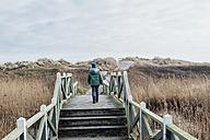 Denmark, Hals, boy in winter clothes in dunes - MJF02017