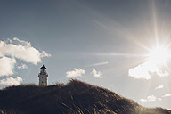 Denmark, Hirtshals, lighthouse at the coast in backlight - MJF02065