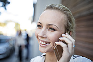 Smiling woman talking on cell phone - ZEF10486