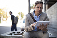 Businessman using tablet outdoors - ZEF10507