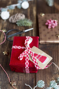 Christmas decoration and wrapped presents on wood - SARF02948