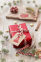 Christmas decoration and wrapped presents on wood - SARF02951