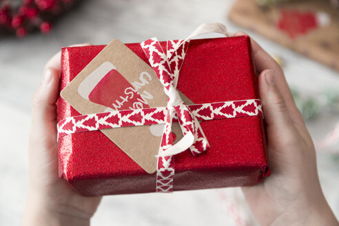 Wrapped Christmas present with card - SARF02957