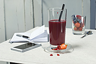 Glass of fruit smoothie on workspace - ASF06022
