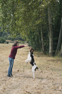 Woman playing with her dog - SKCF00215