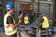 Worker using control in factory hall - JASF01175
