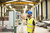 Worker operating control in factory - JASF01214