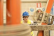 Woman working in factory - JASF01220