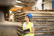 Woman with tablet in factory hall - JASF01223