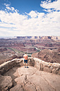 USA, Utah, Young man standing on Dead Horse Point looking to Colorado River - EPF00157