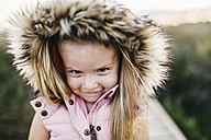 Portrait of smiling little girl with hood - JRFF00876