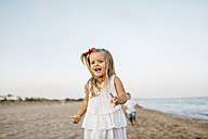 Portrait of little girl having fun on the beach - JRFF00885