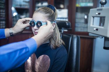 Girl doing eye test at optometrist - ZEF10583