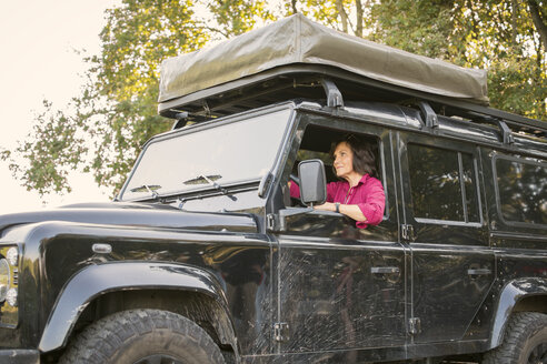 Senior woman on a trip in a cross country vehicle - ONF01018