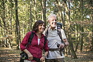 Senior couple hiking in a forest - ONF01024