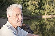 Senior man with dog at a lake - ONF01033