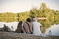 Relaxed senior couple with dog at a lake - ONF01036