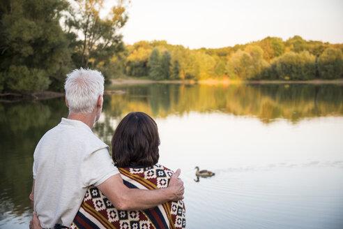 Senior couple at a lake looking at duck - ONF01048