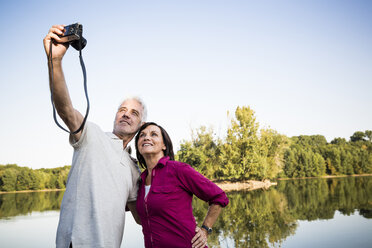 Senior couple at a lake taking a selfie - ONF01066