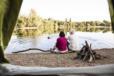 Senior couple camping at a lake - ONF01078