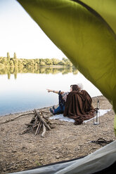 Senior couple camping at a lake - ONF01087
