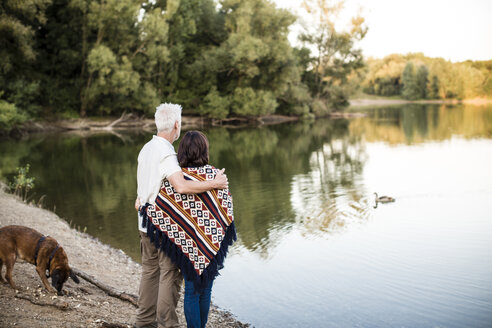 Senior couple with dog at a lake - ONF01096