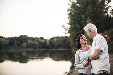 Smiling senior couple at a lake - ONF01108