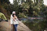 Senior couple embracing at a lake - ONF01111