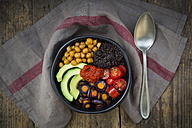 Buddha bowl of black amaranth, avocado, Purple Haze, roasted chickpeas, tomatoes and ajvar - LVF05386