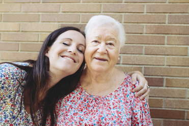 Happy granddaughter embracing her grandmother - GEMF01119