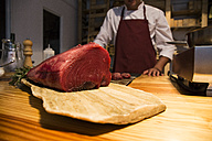 Red tuna steak on a wooden board - ABZF01365
