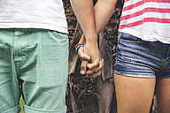 Close-up of couple holding hands - DAPF00404