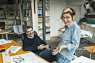 Male and female architects working in office - TCF05163