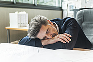 Overworked architect sleeping at desk - TCF05169